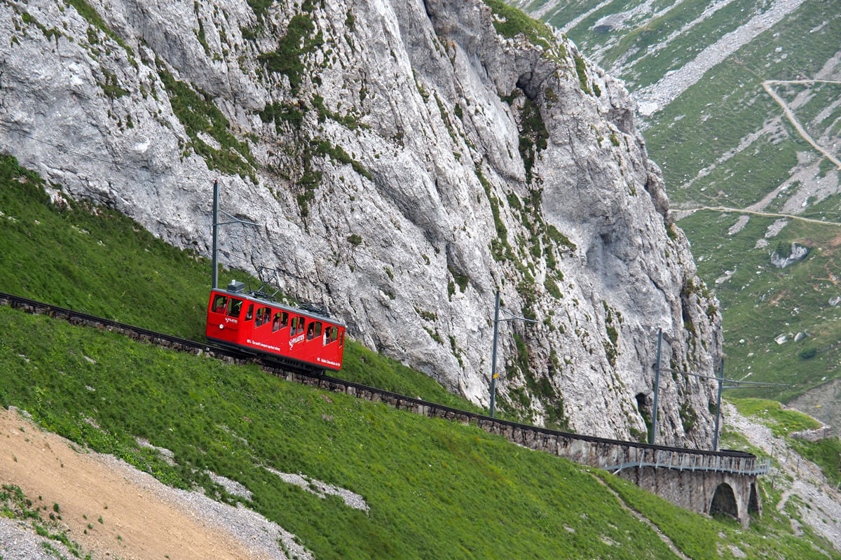 the railway runs along a rocky ledge Pilatus cogwheel